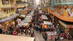 Top view of street marketplace, stalls under shelter in line - stock footage