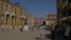 Walking in Campo Santo Stefano on a sunny day in Venice Stock Footage