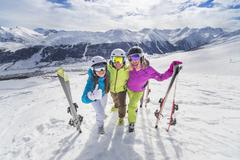 Happy youth in colorful jackets ski alps resort - stock photo
