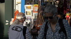 Man buying post cards from a souvenir stall in Venice Stock Footage