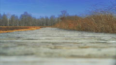 Low angle view of boardwalk on a clear day - stock footage