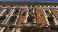 Three flags waving on building in Venice Stock Footage