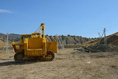 Pipe layer dozer is at pipeline building place. - stock photo