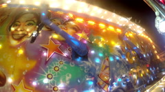 People enjoy entertainment ride screaming at night in luna park Stock Footage