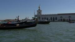 Paddling gondolas near Punta della Dogana di Mare, Venice Stock Footage