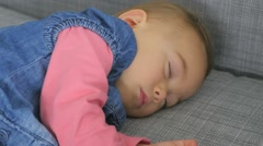 Baby girl taking a nap on couch - stock footage