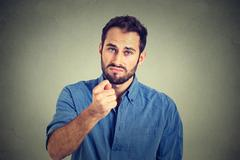 Man giving thumb, finger figa gesture you get zero nothing Stock Photos