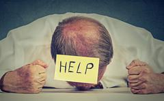 Tired, stressed senior employee needs help - stock photo