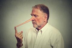 Sad man with long nose worried - stock photo