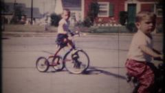 2785 - children on bicycles & tricycles in neighborhood -vintage film home movie Stock Footage