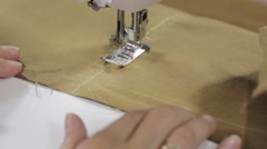 Female hands sewing fabric on sewing machine Stock Footage