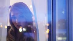 Pretty face girl looking out a window Stock Footage