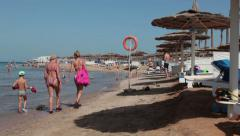 First line hotels sea area with sunbeds and parasols is in the Red Sea. Hurghada Stock Footage