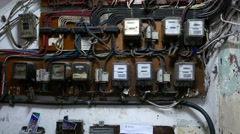 Many electricity meters on wall, dusty and old place Stock Footage