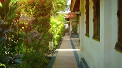Walkway in the Garden Courtyard of a Luxury Resort Hotel Stock Footage