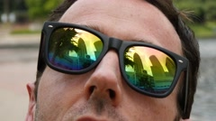 Man looking up at skyscrapers reflective sunglasses 4k petronas towers Stock Footage