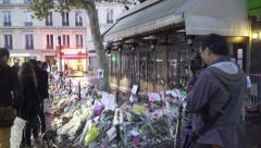 Paris terror attacks - Shrine / memorial in front cafe - stock footage
