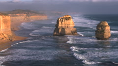 Australia Great Ocean Road 12 Apostles sea stacks golden light eastward zoom Stock Footage