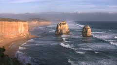 Australia Great Ocean Road 12 Apostles sea stacks golden light eastward Stock Footage
