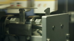 Part of a production line of paper packaging Stock Footage
