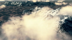 4k flying over snow mountain,huge clouds mass rolling over mountain. Stock Footage