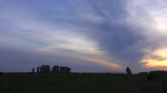 Stonehenge in the distance on the plains of England. - stock footage