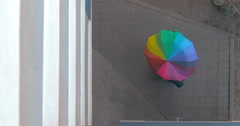 Pedestrian Twists Colored Umbrella Stock Footage