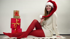 Woman in pantyhose with christmas gifts 4K. Stock Footage