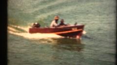 1948  ,Vintage wooden motorboat on lake Stock Footage