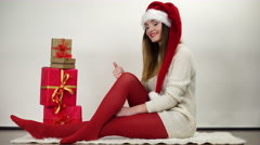 Woman in pantyhose opening christmas gift 4K. - stock footage