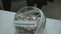 "Ungraded: Visitors Put Money in Glass Bowl With Russian Inscription ""Free Stock Footage"