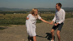 Stock Video Footage of Active Tourism couple outdoors in the mountains during the campaign. Young co