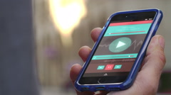 4K Close up of hand holding a smartphone with application on screen outdoors - stock footage