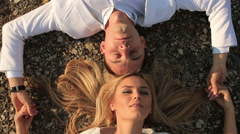 Stock Video Footage of Beautiful sexual couple lying on the ground with mountain views
