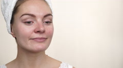 Stock Video Footage of Woman in towel on head with no makeup 4K