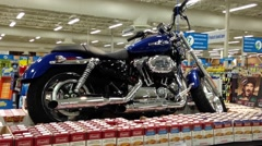 Grand price for motocycle for lucky customer inside Pricesmart foods Stock Footage