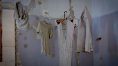Stock Video Footage of Clothes coated with concrete are hanging in the air