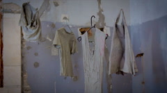 Clothes coated with concrete are hanging in the air - stock footage