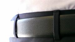 Man (businessman, diplomat, groom) buckles the belt of his pants, closeup Stock Footage