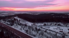 Panoramic aerial shot high road and the industrial district at sunset in winter Stock Footage