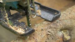 Man Sawing Wood Log Using Power Jigsaw - stock footage