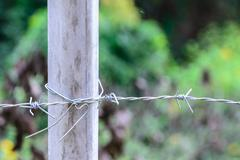 Metal barb fence with cement pole for protect danger area. Stock Photos