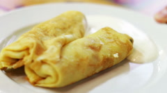 Pancakes with sour cream on a plate in a cafe Stock Footage