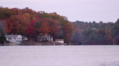 A scenic lake surrounded by fall leaves in Sturbridge, MA. Stock Footage