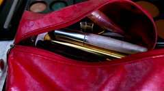 Makeup kit full with makeup tools, someone throws lipsticks inside it Stock Footage