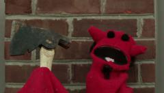 Psycho creepy devil puppet with axe ax Stock Footage