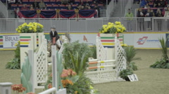 Horse jumping show with young lady riding Stock Footage