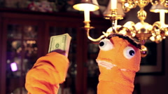 Puppet holding money hold cash Stock Footage