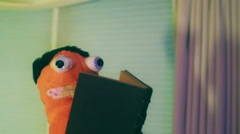 puppet reading book read learn funny comedic - stock footage