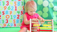 Cute baby girl counting on abacus. Full HD Video Stock Footage